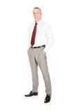 Full length businessman with hands in pockets Stock Image