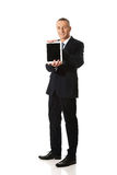 Full length businessman holding digital tablet Royalty Free Stock Photography