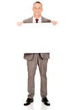 Full length businessman holding empty banner Royalty Free Stock Photos