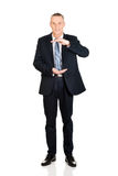Full length businessman holding invisible product Stock Photo