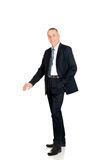 Full length businessman leaning on empty blank Royalty Free Stock Image