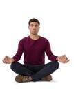 Full length of businessman meditating Stock Image