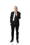 Full length businessman pointing on you Stock Images