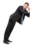 Full length of businessman pushing something. Full-length portrait of business man shoving something who wears suit with blue tie, isolated on white royalty free stock image