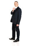 Full length businessman showing a blank card Stock Photos