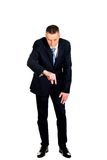 Full length businessman showing small size Royalty Free Stock Photography