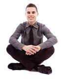 Full length of businessman sitting on the floor Royalty Free Stock Image