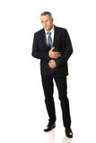 Full length businessman suffering from stomachache Royalty Free Stock Image