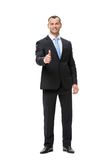 Full length of businessman thumbing up Royalty Free Stock Photography