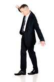 Full length businessman walking carefully Stock Images