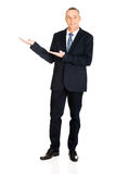 Full length businessman with welcome gesture Royalty Free Stock Photography