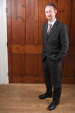 Full Length Businessman with Wood Panels Royalty Free Stock Photo