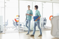 Full-length of businessmen walking at creative work space Stock Photos