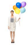 Full length of businesswoman with balloons Stock Images
