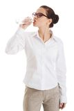 Full length businesswoman drinking water Stock Image