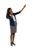 Full length of businesswoman giving presentation. While standing against white background Stock Photo