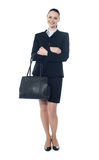Full length of businesswoman with handbag. Beautiful american businesswoman holding a handbag Royalty Free Stock Images