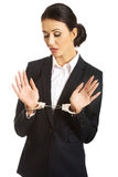 Full length businesswoman with handcuffs Royalty Free Stock Photo