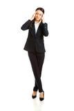 Full length businesswoman having huge headache Stock Images