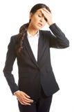 Full length businesswoman having huge headache Stock Photo