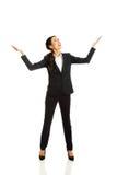 Full length businesswoman holding copyspace Stock Photo