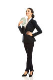 Full length businesswoman holding polish bills Royalty Free Stock Photography