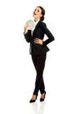 Full length businesswoman holding polish bills Stock Image
