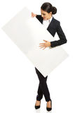 Full length businesswoman holding white banner Royalty Free Stock Photos