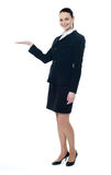 Full length of businesswoman showing copyspace Royalty Free Stock Images