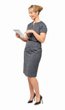 Full Length Of Businesswoman Using Digital Tablet Stock Photography