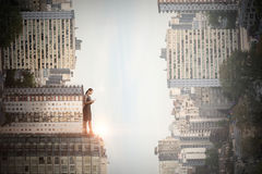 Composite image of full length of businesswoman using mobile phone. Full length of businesswoman using mobile phone against high angle view of modern buildings stock photos