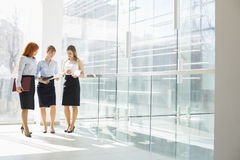 Full-length of businesswomen doing paperwork in office Royalty Free Stock Photography