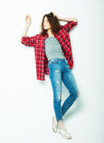 Full length casual fashion woman posing over white background. Studio shoot royalty free stock images