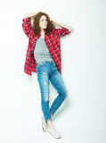 Full length casual fashion woman posing over white background. Studio shoot stock image