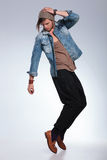 Full length of casual man balancing on toes Royalty Free Stock Photography