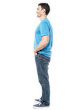 Full length of casual man posing side ways Stock Photos