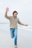 Full length of a casual man running at beach Royalty Free Stock Photo