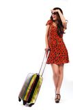 Full length of casual woman standing with travel suitcase. Isolated on white background Royalty Free Stock Photos