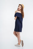 Full length of cheerful cute woman in hat and dress Stock Image