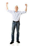 Full length cheerful man with hands up Royalty Free Stock Photo