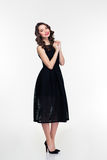 Full length of cheerful retro styled female in black dress Stock Photo