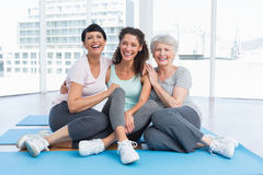 Full length of cheerful women in yoga class Royalty Free Stock Images