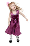 Full length of cheerful young girl jumping Stock Image