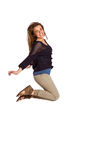 Full length of cheerful young woman jumping Royalty Free Stock Images