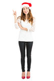 Full length christmas woman pointing to copy space. Stock Images