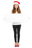 Full length christmas woman showing advertisement banner Stock Images