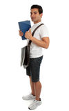 Full length college student thumbs up. Side view of a full length standing college or university student. He is holding a book and giving a thumbs up sign. White Royalty Free Stock Photography