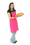 Full length of confectioner with cakes Stock Photography