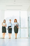 Full-length of confident businesswomen standing in office Stock Photography