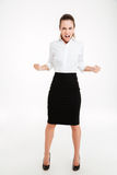 Full length of a confident excited young businesswoman celebrating success Stock Photo